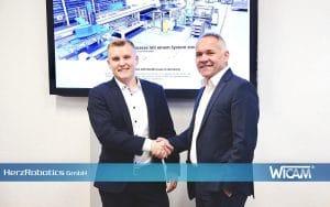 Im Dezember diesen Jahres beschlossen Timo Eigenblut (Geschäftsführer der WiCAM GmbH) und Maximilian Herz (Geschäftsführer der HerzRobotics GmbH) die laufende Kooperation weiter aus zu bauen.
